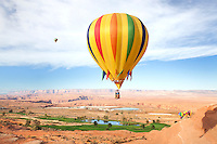 Balloon Regatta over the desert and golf course near Page Arizona. In the back is visible Lake Powell and Glen Canyon..Photo by: Ronald de Hommel / Johannes Abeling
