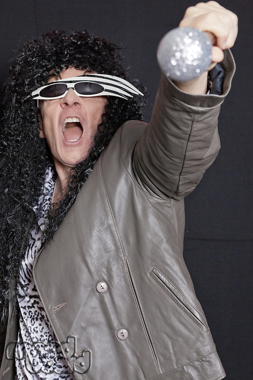 Senior adult man performing over black background