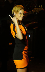 EXCLUSIVE: Singer Rihanna wears a tight orange leather dress while performing live for the inaugural cruise of Royal Caribbean's Oasis of the Seas on November 19, 2009 in Ft. Lauderdale, Florida. 19 Nov 2009 Pictured: Rihanna. Photo credit: MEGA TheMegaAgency.com +1 888 505 6342