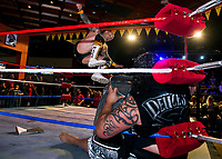 "The ""Master of Mayhem"" Tommy Mack jumps ""Samoan Storm"" AFA Jr during the main event ""Street Fight"" at the Whiskey Barrel's Pro Wrestling Injustice for Brawl event Saturday night to benefit PJ Kearney and Boston Children's Hospital.   (Karen Bobotas/for the Laconia Daily Sun)"
