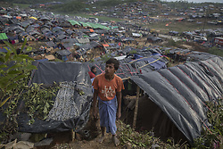 September 19, 2017 - Cox's Bazar, Chittagong, Bangladesh - Homemade tents cover a hillside at Cox's Bazaar Rohingya refugee Camp. Many of the Rohingya fleeing the violence in Myanmar had travelled by boat to find refuge in neighboring Bangladesh. According to United Nations more than 400 thousand Rohingya refugees have fled Myanmar from violence over the last few weeks, most trying to cross the border and reach Bangladesh. (Credit Image: © Can Erok/Depo Photos via ZUMA Wire)