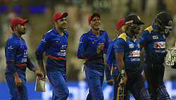 September 18, 2018 - Abu Dhabi, United Arab Emirates - Afghanistan cricketer Mujeeb Ur Rahman and Sri Lankan cricketer Lasith Malinga share a light moment following Sri Lankan cricket teams' loss after the 3rd cricket match of Asia Cup 2018 between Sri Lanka and Afghanistan at the Sheikh Zayed Stadium,Abu Dhabi, United Arab Emirates. 09-17-2018. (Credit Image: © Tharaka Basnayaka/NurPhoto/ZUMA Press)