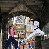 "Artists of the korean show "" Jump ""  performing outside the Edinburgh Assembly Hall,  during the Edinburgh Festival 2006.<br />"