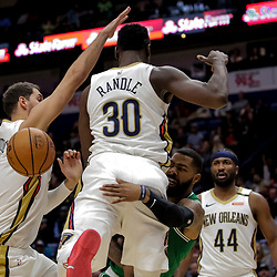 Nov 26, 2018; New Orleans, LA, USA; Boston Celtics forward Marcus Morris (13) passes as New Orleans Pelicans forward Julius Randle (30) and forward Nikola Mirotic (3) defend during the second half at the Smoothie King Center. Mandatory Credit: Derick E. Hingle-USA TODAY Sports