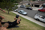 June 7, 2017 / Yorba Linda, Calif.<br /> <br /> Using a hill for inverted sit ups with a medicine ball are the last station during an intense morning workout for Aaron Pico as he trains for his upcoming MMA debut fight.(Melissa Lyttle for ESPN)
