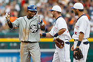 May 24, 2014; Detroit, MI, USA; Texas Rangers shortstop Elvis Andrus (1) reacts in front of Detroit Tigers shortstop Andrew Romine (27) and second baseman Ian Kinsler (right) after being called out trying to steal second on a reviewed play in the fifth inning at Comerica Park. Mandatory Credit: Rick Osentoski-USA TODAY Sports