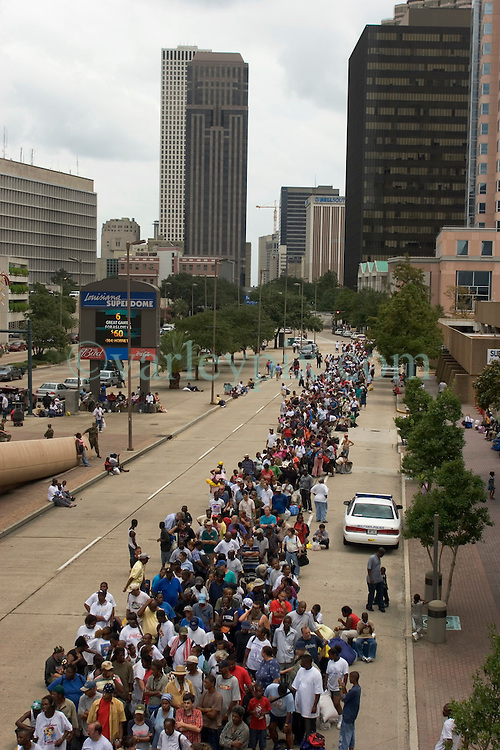 28th August, 2005. Hurricane Katrina, New Orleans, Louisiana. Thousands of people wait in line for a place of shelter in the Superdome.