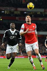 Arsenal's Oliver Giroud in action - Photo mandatory by-line: Mitchell Gunn/JMP - Tel: Mobile: 07966 386802 23/11/2013 - SPORT - Football - London - Emirates Stadium - Arsenal v Southampton - Barclays Premier League