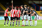 Exeter City and Lincoln City line up for a corner during the EFL Sky Bet League 2 match between Exeter City and Lincoln City at St James' Park, Exeter, England on 19 August 2017. Photo by Graham Hunt.