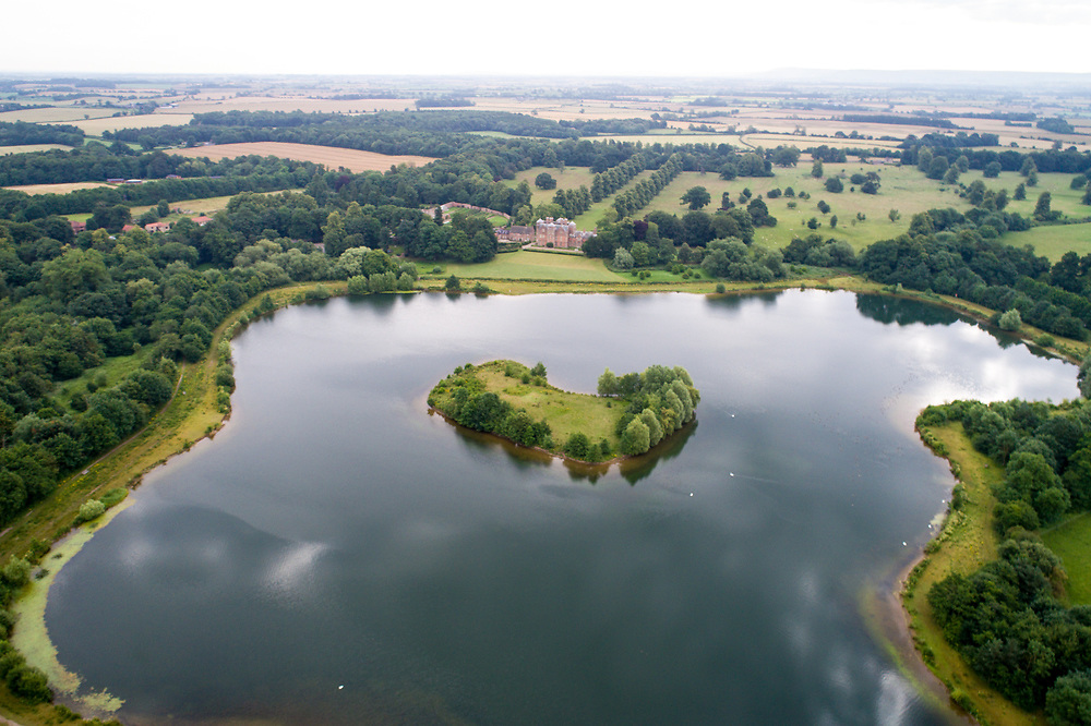 Looking out over lake on the grounds of Kiplin Hall, North Yorkshire, England