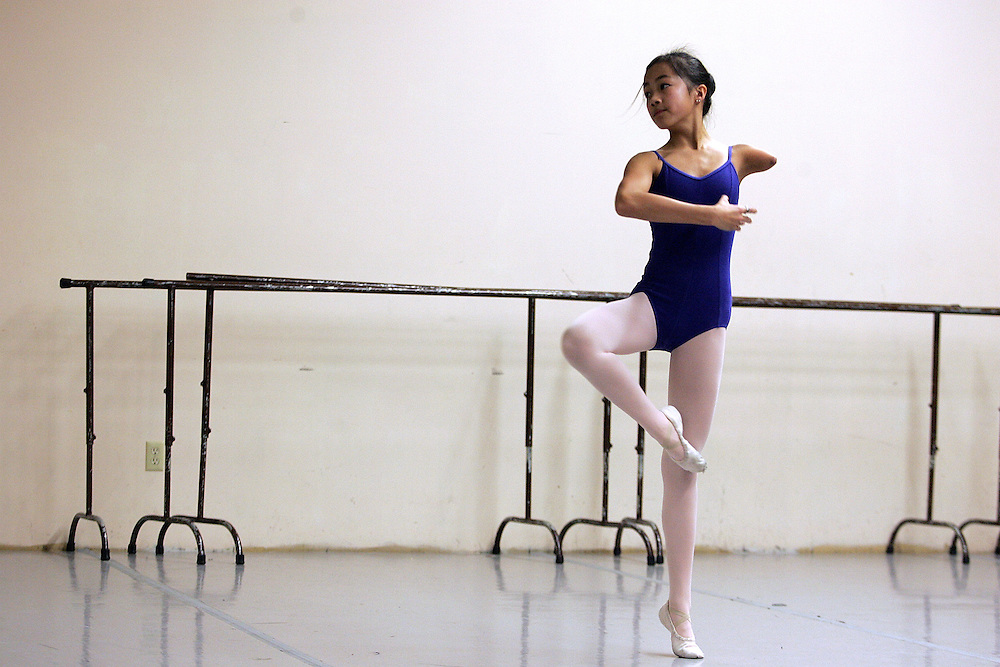2/10/2009 Easthampton, MA-  Lani Dickinson, 14, practices pirouetting  during a Pioneer Valley Ballet Class. Lani was born in China with a congenital defect and adopted by an American family.  Despite her disability, she trains hard as a ballerina and would like to someday be a professional dancer.