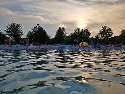 August 1, 2018 - Munich, Bavaria, Germany - At Munich's Langwiedersee (Lake Langwied) Germans escape the heatwave during sunset where above-average temperatures of 36 degrees Celcius have been seen.  The heatwave is expected to persist for some days more. (Credit Image: © Sachelle Babbar via ZUMA Wire)