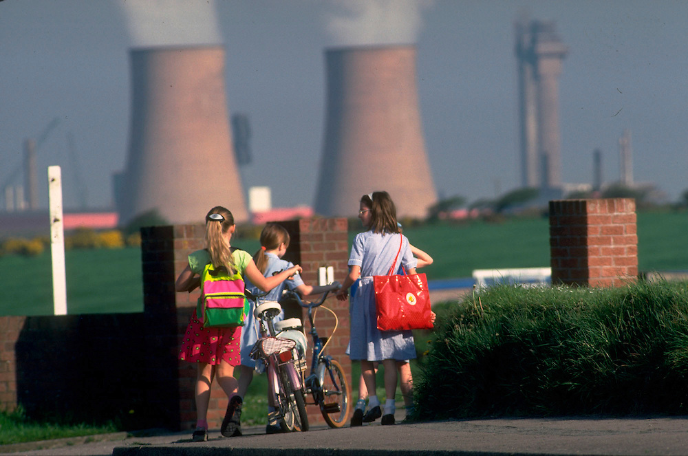 Sellafield reprocessing plant, Cumbria, UK. Children in the nearby village of Seascale showing its proximity to the plant.    Accession #: 0.90.113.001.04