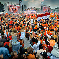 The Netherlands, Amsterdam, 13-07-2010.<br /> Football, World championships.<br /> Thousands of Dutch people give a tribute to the national football team on the Museumplein after The Netherlands has become second on the World Championships in South Africa<br /> Photo : Klaas Jan van der Weij