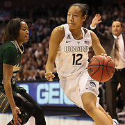 Saniya Chong, UConn, drives past Shaleth Stringfield, USF, during the UConn Huskies Vs USF Bulls Basketball Final game at the American Athletic Conference Women's College Basketball Championships 2015 at Mohegan Sun Arena, Uncasville, Connecticut, USA. 9th March 2015. Photo Tim Clayton