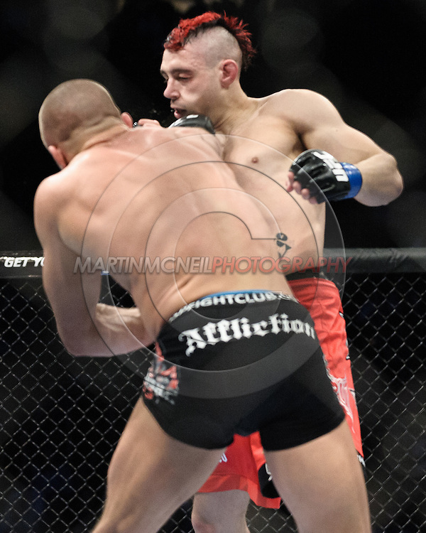 "NEWARK, NEW JERSEY, MARCH 27, 2010: Dan Hardy (facing) and Georges St. Pierre are pictured during their bout at ""UFC 111: St. Pierre vs. Hardy"" in the Prudential Center, New Jersey on March 27, 2010"