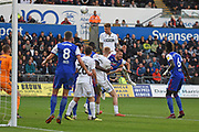 Swansea City defender Joe Rodon (22) heads the ball at goal during the EFL Sky Bet Championship match between Swansea City and Ipswich Town at the Liberty Stadium, Swansea, Wales on 6 October 2018.
