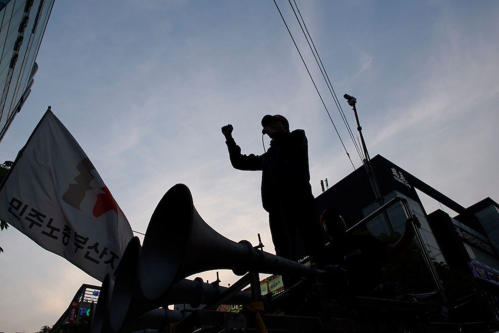 A labor leader speaks during a rally organized by the Korean Confederation of Trade Unions in Busan, South Korea.