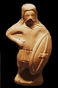 A statuette of a barbarian soldier carrying a Celtic shield. Circa 5th Century AD British