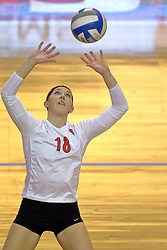 07 November 2014:  Kaitlyn Early sets the ball for a strike during an NCAA womens volleyball match between the Loyola Ramblers and the Illinois State Redbirds at Redbird Arena in Normal IL