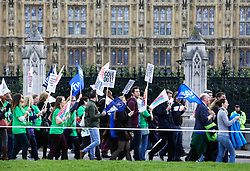 Licensed to London News Pictures 17/10/2013<br /> London. UK.<br /> Teachers on strike march past the Houses of Parliament, whiilst protesting government pay cuts.<br /> Photo credit: Anna Branthwaite/LNP