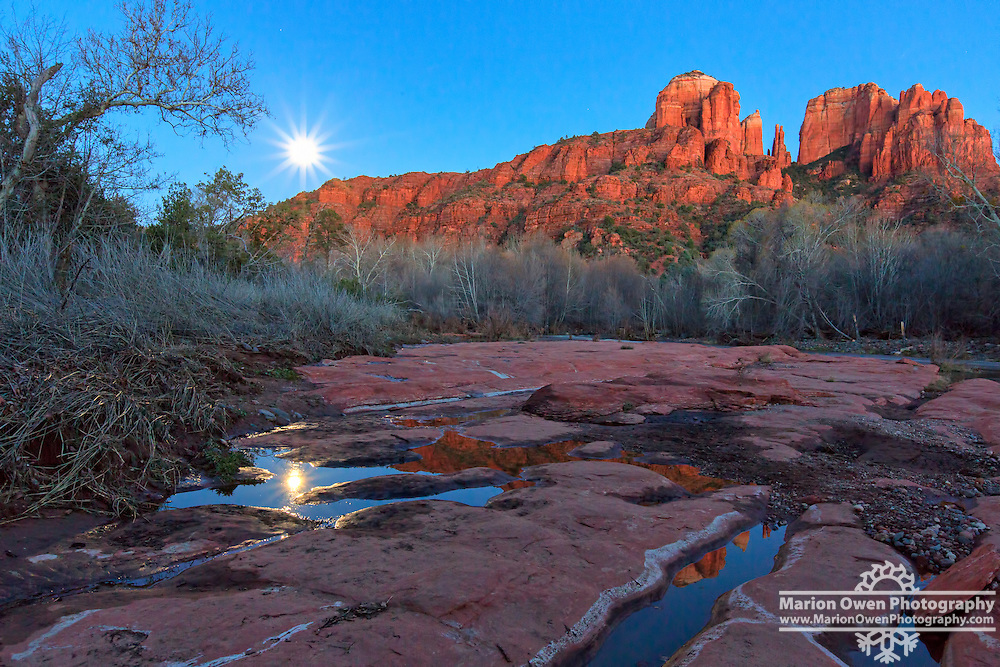 Cathedral Rock reflected in pools by Oak Creek at Red Rock crossing with full moon, Red Rock State Park near Sedona, Arizona