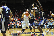 """Ole Miss Rebels forward Anthony Perez (13) vs. TCU Horned Frogs forward Kenrich Williams (34) and TCU Horned Frogs forward Chris Washburn (33) at the C.M. """"Tad"""" Smith Coliseum in Oxford, Miss. on Thursday, December 4, 2014. TCU won 66-54."""