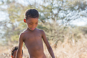 Portrait of a Bushman child. Photographed in Namibia