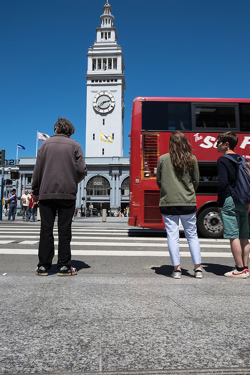 Pedestrians wait to cross street in front of San Francisco's Ferry Building | May 6, 2014