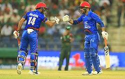 September 20, 2018 - Abu Dhabi, United Arab Emirates - Afghanistan cricketers Rashid Khan and Gulbadin  Naib congratulate each other during the 6th cricket match of Asia Cup 2018 between Bangladesh and Afghanistan at the Sheikh Zayed Stadium,Abu Dhabi, United Arab Emirates on September 20, 2018. (Credit Image: © Tharaka Basnayaka/NurPhoto/ZUMA Press)