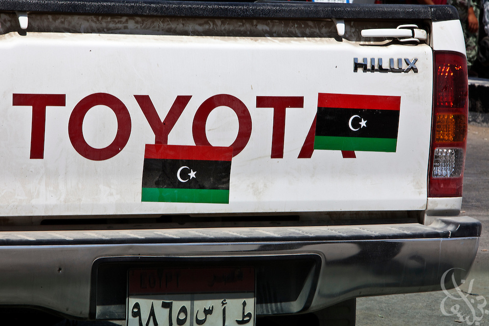"""An imported Libyan pickup decorated with """"Free Libya"""" stickers is seen parked near the Egyptian-Gaza border July 26, 2011 in the North Sinai town of Rafah, Egypt. Since the Egyptian revolution, a decline in the number of police across the Sinai has resulted in a boom in the smuggling business, including the trade of both stolen and legally purchased automobiles from Libya that are driven to Rafah, and then smuggled into neighboring Gaza via smuggling tunnels..Slug:Sinai.Credit: Scott Nelson for the new York Times"""