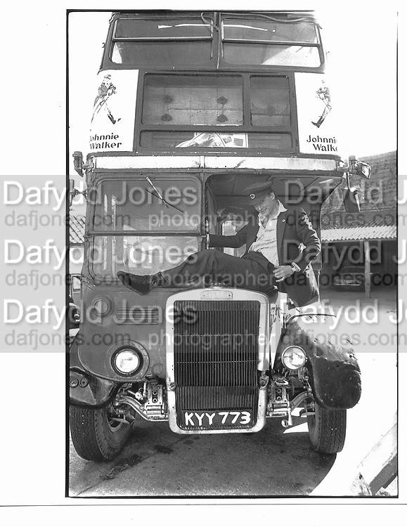 Lord Rufus Isaacs with his bus in gloucestershire. © Copyright Photograph by Dafydd Jones 66 Stockwell Park Rd. London SW9 0DA Tel 020 7733 0108 www.dafjones.com
