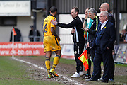 Newport County Manager Michael Flynn and Joss Labadie during the EFL Sky Bet League 2 match between Newport County and Crawley Town at Rodney Parade, Newport, Wales on 1 April 2017. Photo by Andrew Lewis.