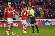 Conor Chaplin of Barnsley FC speaks with referee Keith Stroud during the EFL Sky Bet Championship match between Barnsley and Queens Park Rangers at Oakwell, Barnsley, England on 14 December 2019.