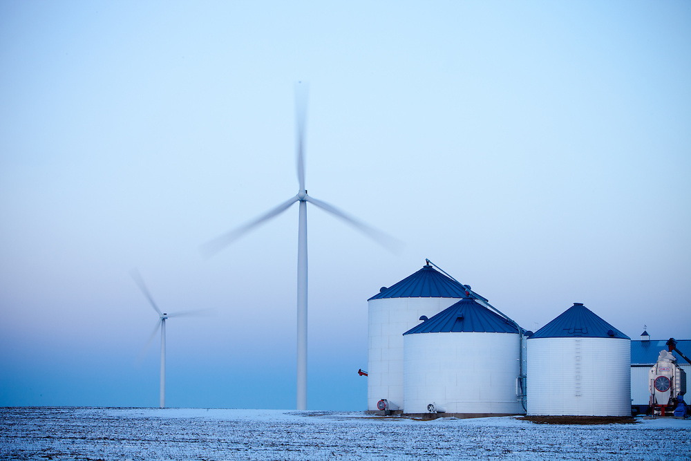 Wind turbines spin in a farmer's field on a cold winter evening in Central Illinois.