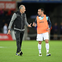 Swansea City manager Francesco Guidolin gives Leon Britton of Swansea City pre match instructions. - Mandatory by-line: Alex James/JMP - 21/09/2016 - FOOTBALL - Liberty Stadium - Swansea, England - Swansea City v Manchester City - EFL Cup