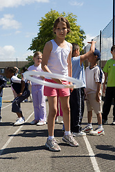 Girl taking part in throwing competition in school playground,