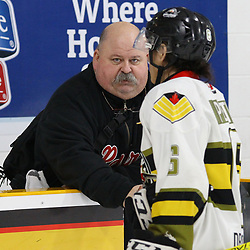 TRENTON, ON  - MAY 5,  2017: Canadian Junior Hockey League, Central Canadian Jr. &quot;A&quot; Championship. The Dudley Hewitt Cup Game 7 between Georgetown Raiders and the Powassan Voodoos.   Georgetown Raiders trainer shakes  Bo Peltier #6 of the Powassan Voodoos hand post game.<br /> (Photo by Alex D'Addese / OJHL Images)