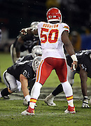 Kansas City Chiefs outside linebacker Justin Houston (50) points during the NFL week 12 regular season football game against the Oakland Raiders on Thursday, Nov. 20, 2014 in Oakland, Calif. The Raiders won their first game of the season 24-20. ©Paul Anthony Spinelli