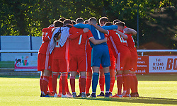 BANGOR, WALES - Monday, October 15, 2018: Wales players form a group huddle before the UEFA Under-19 International Friendly match between Wales and Poland at the VSM Bangor Stadium. (Pic by Paul Greenwood/Propaganda)