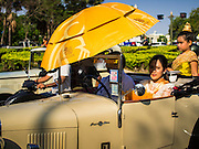 19 APRIl 2014 - BANGKOK, THAILAND: Thais in a Singer convertible during the parade at the Rattanakosin Festival in Bangkok. Rattanakosin is the name of the man made island that is the heart of the old city. Bangkok was formally founded as the capital of Siam (now Thailand) on 21 April 1782 by King Rama I, founder of the Chakri Dynasty. Bhumibol Adulyadej, the current King of Thailand, is Rama IX, the ninth King of the Chakri Dynasty. The Thai Ministry of Culture organized the Rattanakosin Festival on Sanam Luang, the royal parade ground in the heart of the old part of Bangkok, to celebrate the city's 232nd anniversary.    PHOTO BY JACK KURTZ
