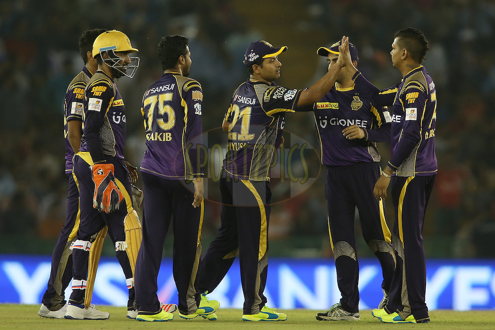 Piyush Chawla of Kolkata Knight Riders nd Sunil Narine of Kolkata Knight Riders celebrate getting Glenn Maxwell of Kings XI Punjab wicket during match 13 of the Vivo Indian Premier League (IPL) 2016 between the Kings XI Punjab and the Kolkata Knight Riders held at the IS Bindra Stadium, Mohali, India on the 19th April 2016<br /> <br /> Photo by Shaun Roy / IPL/ SPORTZPICS