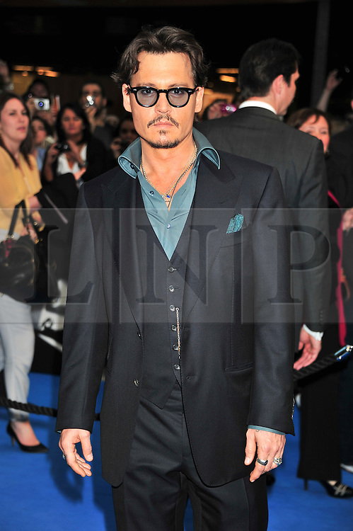 """© licensed to London News Pictures. London, UK  12/05/11 Johnny Depp attends the UK premiere of Pirates of the Carribean 4 """"on Stranger Tides"""" at Londons Westfield . Please see special instructions for usage rates. Photo credit should read AlanRoxborough/LNP"""