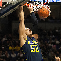 Michigan's Jordan Morgan (52) dunks during the second half of an NCAA college basketball game in University Park, Pa., Wednesday, Feb. 27, 2013.