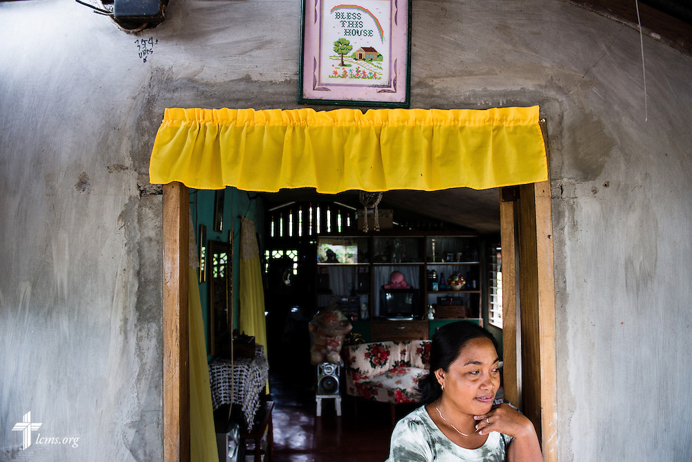 A woman waits for visitors at a home in Mayahag, Leyte Province, Philippines, on Saturday, March 15, 2014. LCMS Communications/Erik M. Lunsford