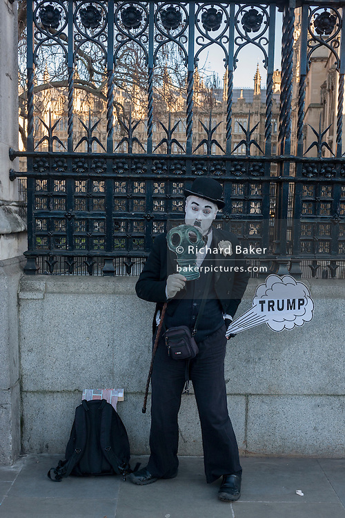 Outside Britain's Palace of Westminster parliament, a Charlie Chaplin character making a Donald trump joke, on the day of Trump's inauguration as the 45th US president, on 20th January, in Parliament Square, London borough of Westminster, England.