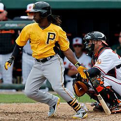 Mar 1, 2013; Sarasota, FL, USA; Pittsburgh Pirates center fielder Andrew McCutchen (22) grounds out against the Baltimore Orioles during the top of the fifth inning of a spring training game at Ed Smith Stadium. Mandatory Credit: Derick E. Hingle-USA TODAY Sports