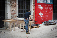 VENICE, ITALY - 1 MAY 2017: A worker is seen here at work at the Arsenale,  an exhibition venue of the 57th International Art Exhibition, one week before the inauguration in Venice, Italy, on May 1st 2017.<br /> <br /> The 57th International Art Exhibition, titled VIVA ARTE VIVA and curated by Christine Macel, is organized by La Biennale di Venezia chaired by Paolo Baratta. VIVA ARTE VIVA will unfold over the course of nine chapters or families of artists, beginning with two introductory realms in the Central Pavilion, followed by another seven across the Arsenale through the Giardino delle Vergini. 120 are the invited artists from 51 countries; 103 of these are participating for the first time. <br /> <br /> The Exhibition will also include 85 National Participations in the historic Pavilions at the Giardini, at the Arsenale and in the historic city centre of Venice. 3 countries will be participating for the first time: Antigua and Barbuda, Kiribati, Nigeria.