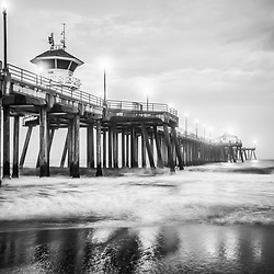 Picture of Huntington Beach Pier in black and white. Huntington Beach is a popular Orange County Southern California beach city also known as Surf City USA.
