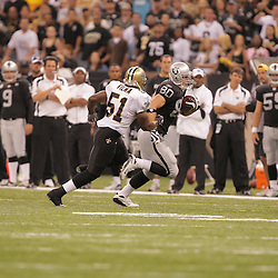 2008 October, 12: Oakland Raiders tight end Zach Miller (80) runs away from New Orleans Saints linebacker Jonathan Vilma (51) during a week six regular season game between the Oakland Raiders and the New Orleans Saints at the Louisiana Superdome in New Orleans, LA.